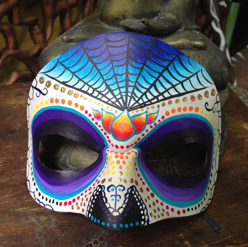 Masks and murals for Dia de los muertos mural
